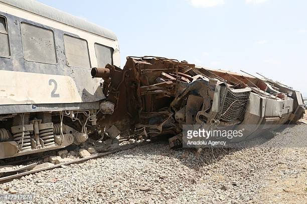 The carriages of a train is seen after it derailed following a collision with a truck which killed 17 people near the town of Fahs south of the...