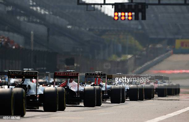 The cars line up on thje grid during the Formula One Grand Prix of China at Shanghai International Circuit on April 12 2015 in Shanghai China