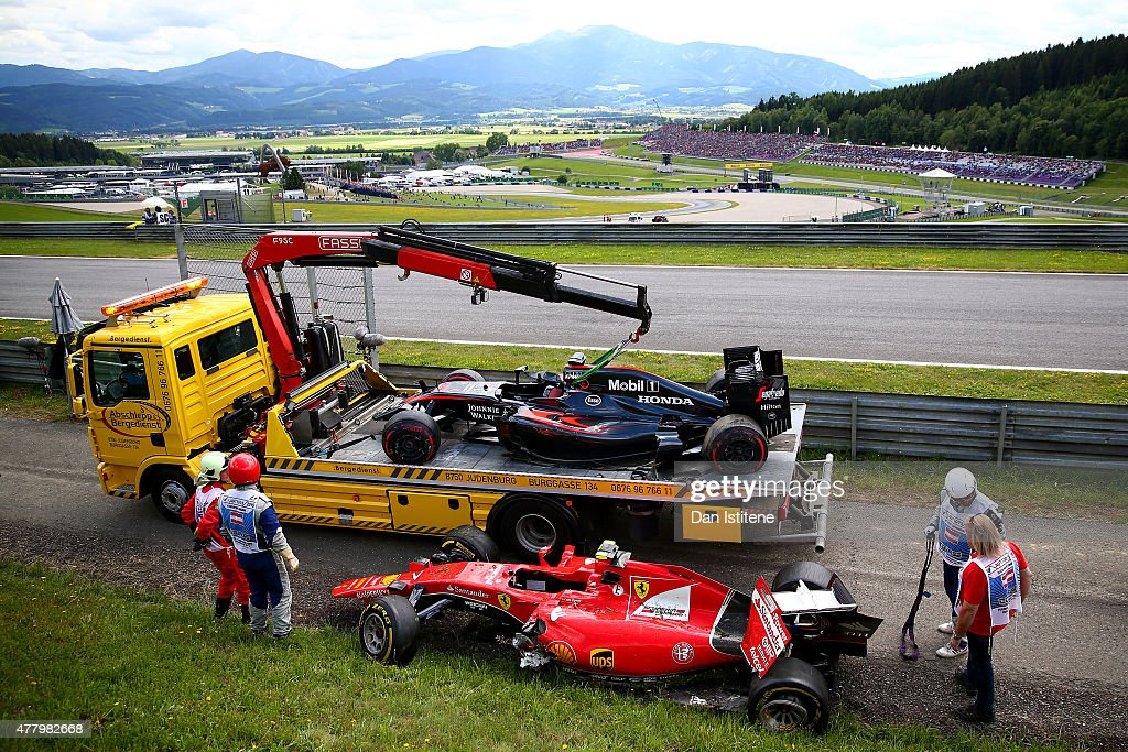 The cars of <a gi-track='captionPersonalityLinkClicked' href=/galleries/search?phrase=Fernando+Alonso+-+Pilota+di+auto+da+corsa&family=editorial&specificpeople=12323351 ng-click='$event.stopPropagation()'>Fernando Alonso</a> of Spain and McLaren Honda and <a gi-track='captionPersonalityLinkClicked' href=/galleries/search?phrase=Kimi+Raikkonen&family=editorial&specificpeople=201904 ng-click='$event.stopPropagation()'>Kimi Raikkonen</a> of Finland and Ferrari wait to be returned to the garages after crashing during the Formula One Grand Prix of Austria at Red Bull Ring on June 21, 2015 in Spielberg, Austria.