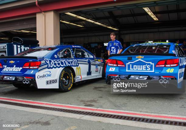 The cars of Monster Energy NASCAR Cup Series driver Jamie McMurray and Monster Energy NASCAR Cup Series driver Jimmie Johnson sit in the garage prior...