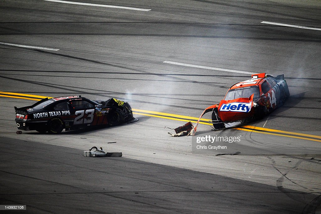 The cars of Robert Richardson Jr., driver of the #23 North Texas Pipe Chevrolet, and Eric McClure, driver of the #14 Hefty/Reynolds Wrap Toyota, sit wrecked after an incident during the NASCAR Nationwide Series Aaron's 312 at Talladega Superspeedway on May 5, 2012 in Talladega, Alabama.