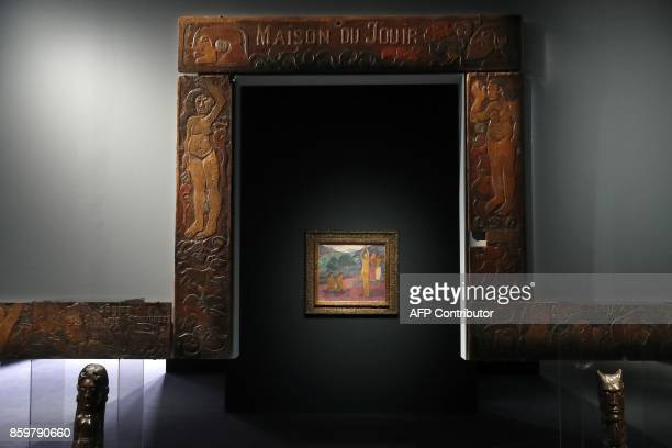 The carved wooden entrance of the house of French painter Paul Gauguin on the Marquesas Islands is displayed during the exhibition entitled 'Gauguin...
