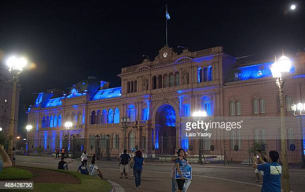 The Casa Rosada Government Palace is illuminated in blue to mark the World Autism Awareness Day on April 2 2015 in Buenos Aires Argentina
