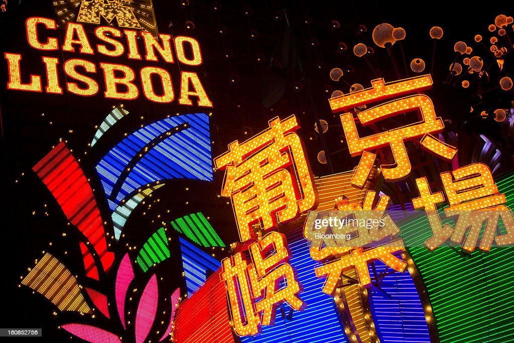 The Casino Lisboa, operated by SJM Holdings Ltd., stands illuminated at night in Macau, China, on Wednesday, Feb. 6, 2013. Casino industry revenue in the gambling hub climbed 14 percent to a record 304 billion patacas ($38 billion) last year. Photographer: Lam Yik Fei/Bloomberg via Getty Images