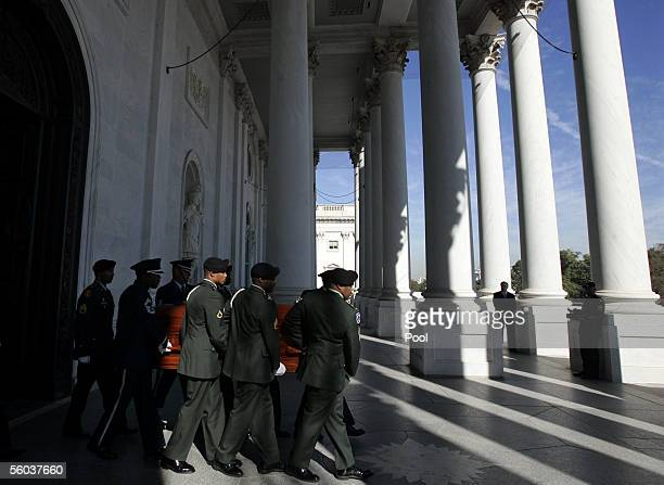 The casket bearing the remains of civil rights icon Rosa Parks is carried out of the Rotunda of the US Capitol building October 31 2005 in Washington...