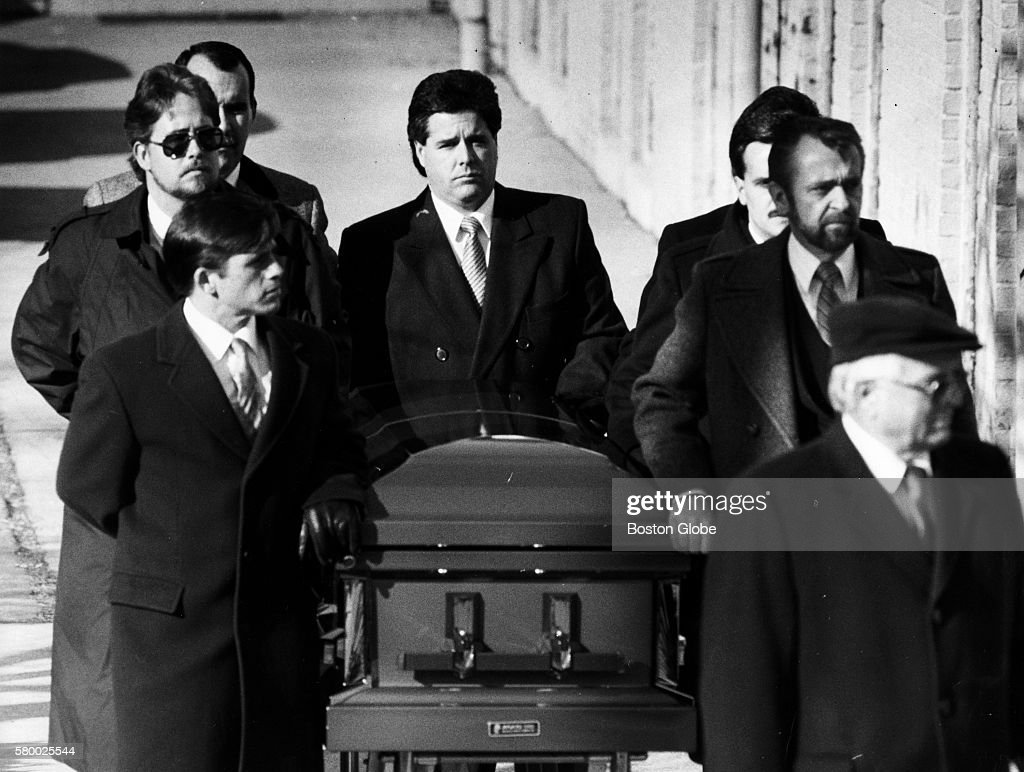 The casket carrying Charles Stuart's body is rolled away at Immaculate Conception Church in Revere Mass on Jan 7 1990 Stuart committed suicide after...