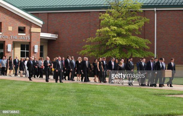 The casket carrying the remains of Otto Warmbier is carried out of Wyoming High School in Wyoming Ohio on June 22 following the funeral for Otto...