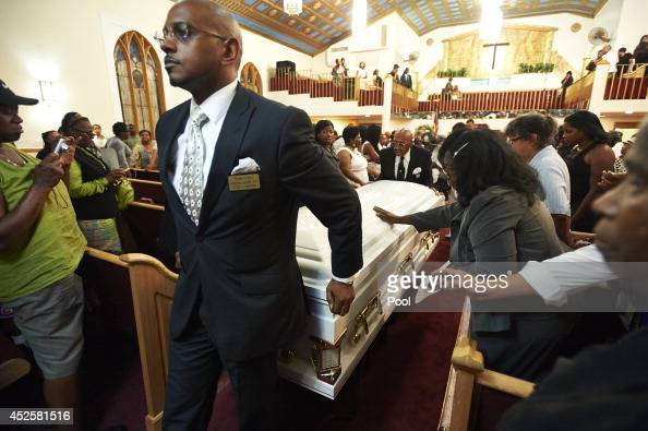 The casket containing the body of Eric Garner is moved from Bethel Baptist Church during his funeral service on July 23 2014 in the Brooklyn borough...