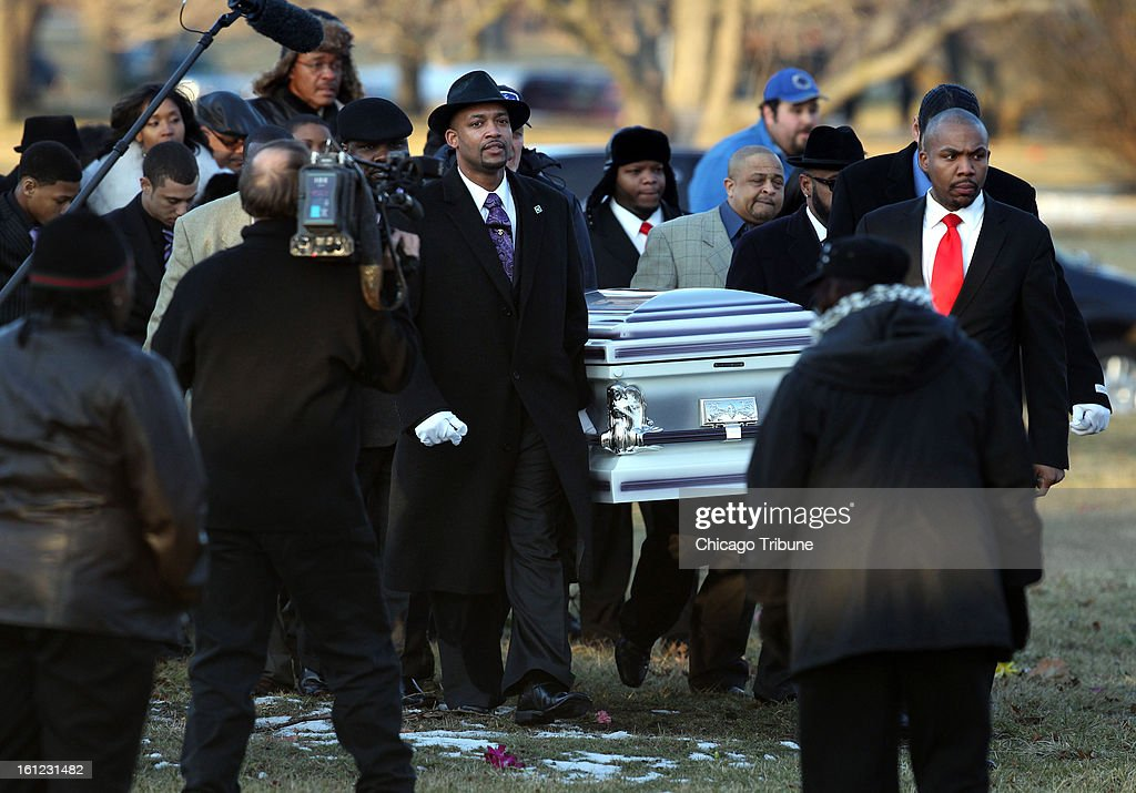The casket containing the body of Hadiya Pendleton is carried to her burial site at Cedar Park Cemetery in Riverdale, Illinois, on Saturday, February 9, 2013.