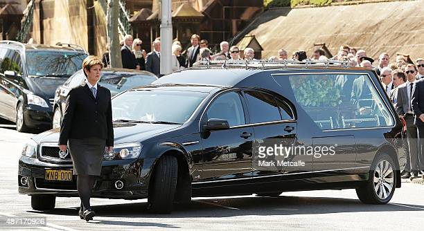 The casket of Bart Cummings is driven away in a hearse following the State Funeral Service for Australian horse racing trainer Bart Cummings at St...