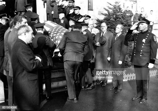 The casket of Boston Police officer Charles McNabb killed by fleeing gunmen in the line of duty is carried into St Columbkille Church in the Brighton...