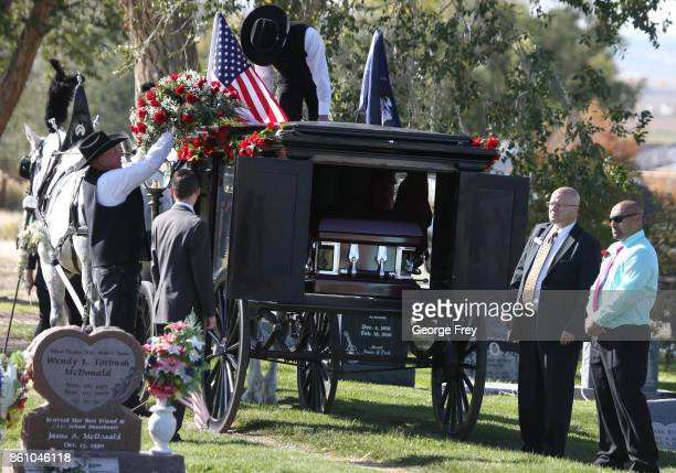 The casket of Heather Lorraine Alvarado arrives at the cemetery for burial by horse drawn hurst on October 13 2017 in Enoch Utah Alvarado was a 35...