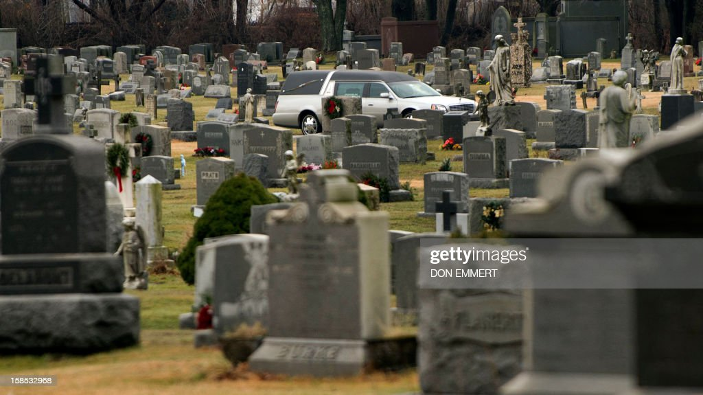 The casket of James Mattioli is driven through St John's Roman Catholic Cemetery December 18 2012 in Darien Connecticut Mattioli is one of 20...
