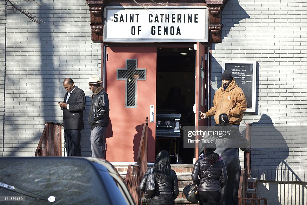 The casket of Kimani Gray, 16, rests inside the St. Catherine of Genoa Church as friends and family arrive for his funeral on March 23, 2013 in the Brooklyn borough of New York City. Kimani Gray was shot and killed by New York police officers for allegedly pointing a gun at them.