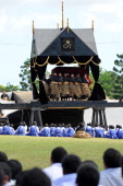 The casket of King George Tupou V at Mala'ekula is removed by the bearer party from black and gold catafalque for entombment in the capital...