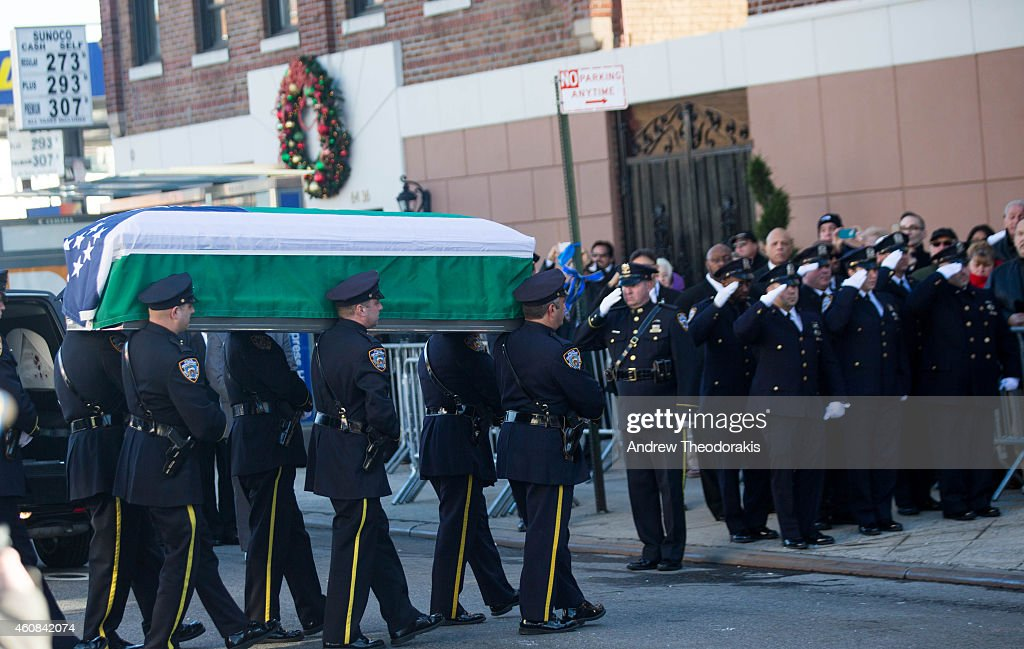 The casket of New York City police officer Rafael Ramos is carried into Christ Tabernacle Church prior to his wake on December 26 2014 in the...