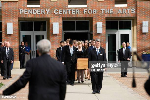 The casket of Otto Warmbier is carried out from his funeral at Wyoming High School June 22 2017 in Wyoming Ohio Otto Warmbier the 22yearold college...