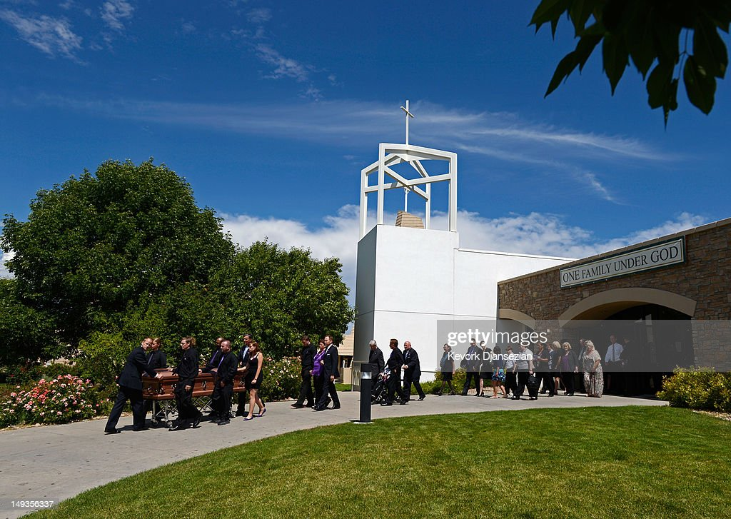 The casket of shooting victim Alexander Jonathan 'A.J.' Boik, 18, who recently graduated from Gateway High School, is wheeled by his classmates from the Queen of Peace Catholic Church after the funeral July 27, 2012 in Aurora, Colorado. Twenty-four-year-old James Holmes is suspected of killing 12 and injuring 58 others July 20 during a shooting rampage at a screening of 'The Dark Knight Rises' in Aurora, Colorado.