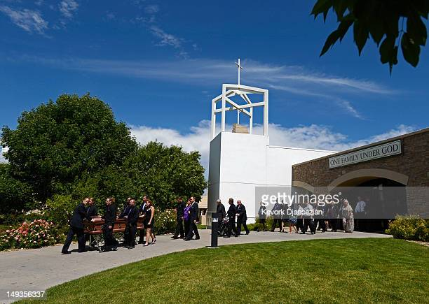 The casket of shooting victim Alexander Jonathan 'AJ' Boik who recently graduated from Gateway High School is wheeled by his classmates from the...