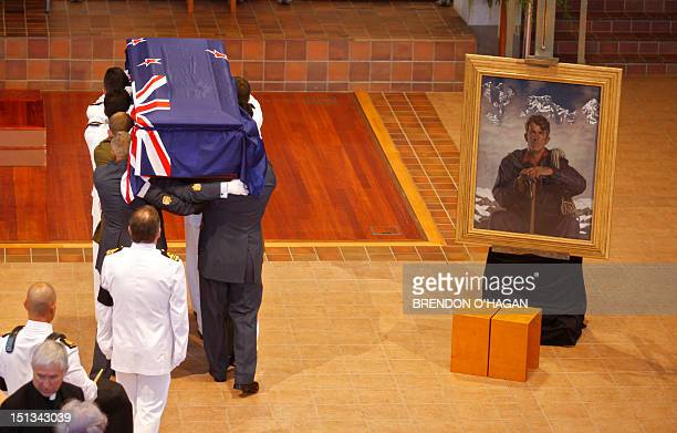 The casket of Sir Edmund Hillary the first person to climb Mount Everest arrives at the Auckland Cathedral of the Holy Trinity in Parnell 21 January...
