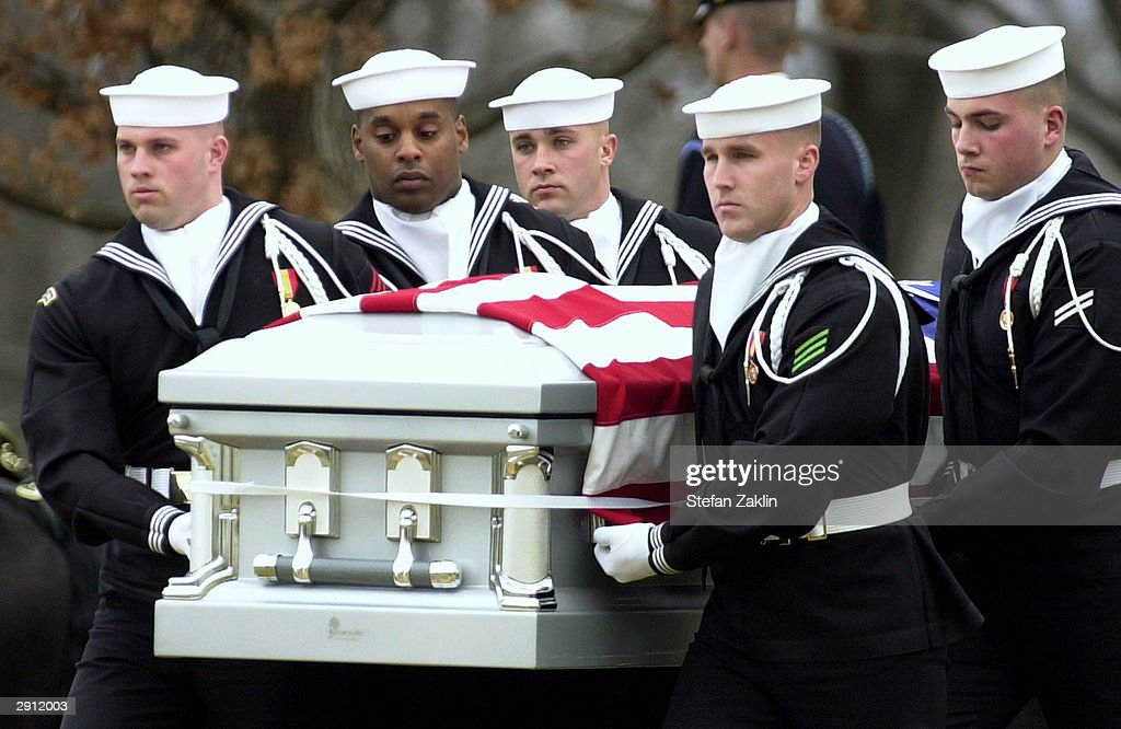 The casket of space shuttle Columbia Mission Specialist Captain David Brown is carried to a gravesite in Arlington National Cemetery March 12, 2003 in Arlington, Virginia. The one-year anniversary of the space shuttle Columbia disaster during re-entry will be marked February 1, 2004.