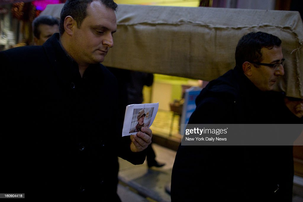 The casket of Staten Island mom Sarai Sierra is carried through Galatasaray, a neighborhood in Istanbul to a hearse that will take the body back to New York. Zafer Ozbilici, who helped launch the campaign printing flyers to find Sierra, holds a photo of her.