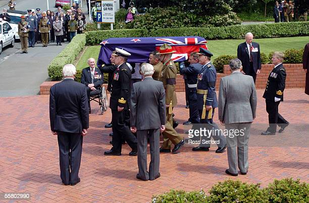 The casket of the unknown warrior leaves the Wellington Cathedral of St Paul between an honour guard of ex servicemen before interment at the...