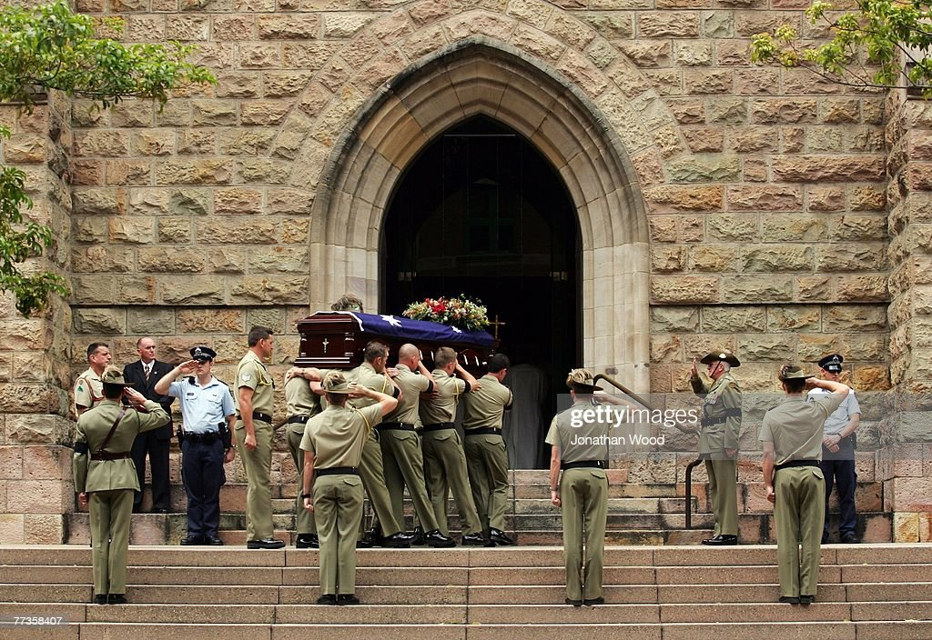 The casket of Trooper David Pearce is carried into the Cathedral of Saint Stephen during his military funeral on October 17 2007 in Brisbane...