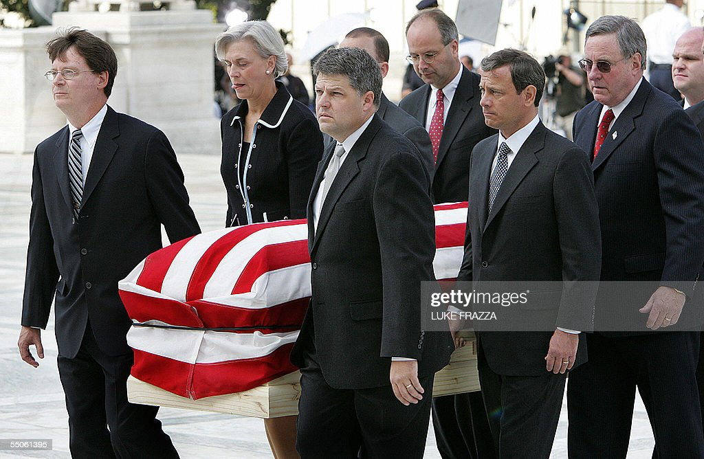 The casket of US Supreme Court Chief Justice William Rehnquist is carried by his former Court clerks up the stairs of the Supreme Court in Washington...