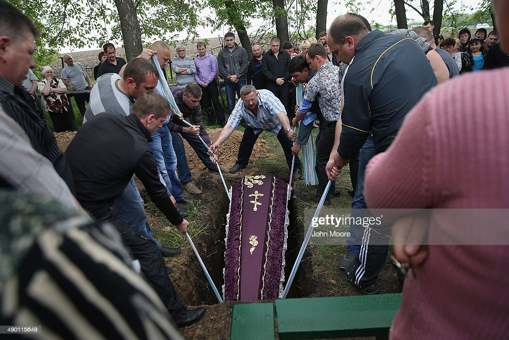 The casket of Yuri Grigorievich, who was alledgedy killed by Ukrainian national guard troops on election day, is lowered into the ground on May 13, 2014 in Dimitrov, Ukraine. The killing during Sunday's sovereignty referendum in the town of Krasnoarmeisk was the latest in a series of deaths from clashes between Ukranian security forces and pro-Russian activists in eastern Ukraine.