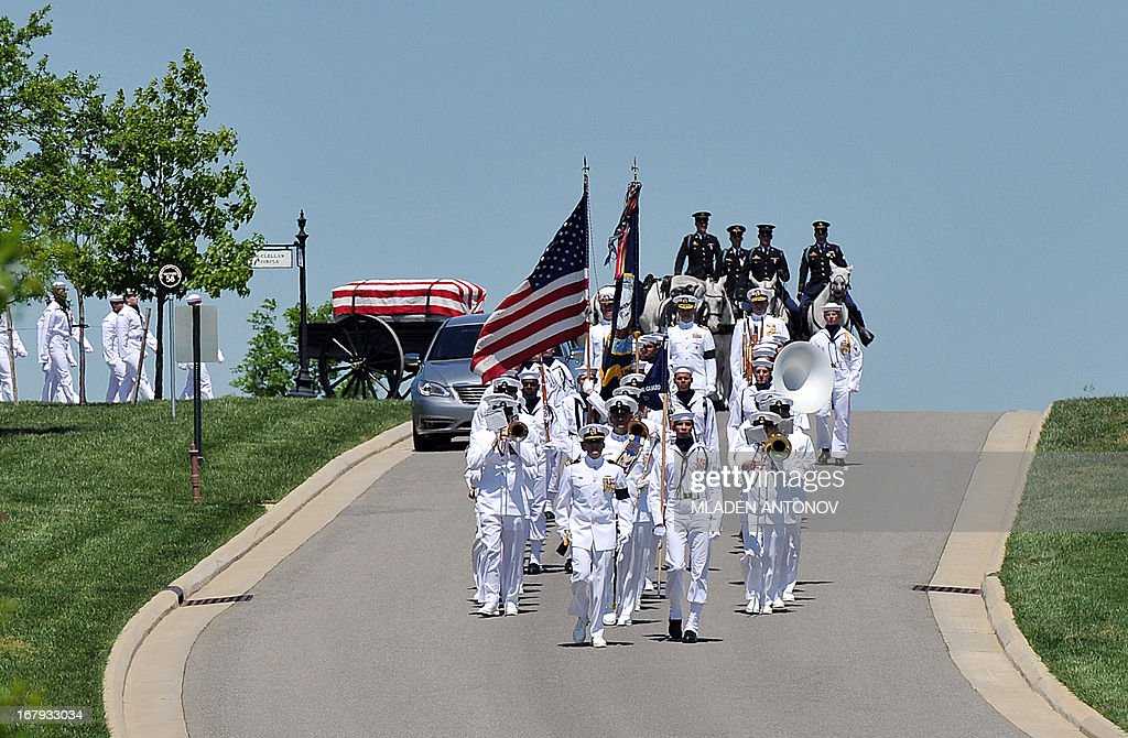 The casket with the remains of four missing US Navy Sailors from the Vietnam War arrives for a burial service at Arlington National Cemetery on May 02, 2013 in Arlington, Virginia. The remains of Lt. Dennis Peterson, Ensign Donald Frye, and Aviation Antisubmarine Warfare Technicians William Jackson and Donald McGrane were buried in a single casket.