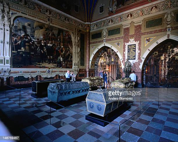 The caskets of King Christian IV and his family lie in the Roskilde cathedral. The giant painting behind shows Christian IV rallying his troops during the 1644 sea battle of Kolbergerheide.