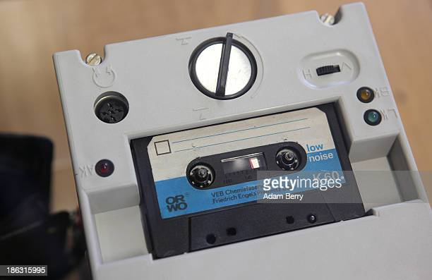 The cassette recorder of an eavesdropping device is displayed at the Stasi or East German Secret Police Museum on October 30 2013 in Berlin Germany...