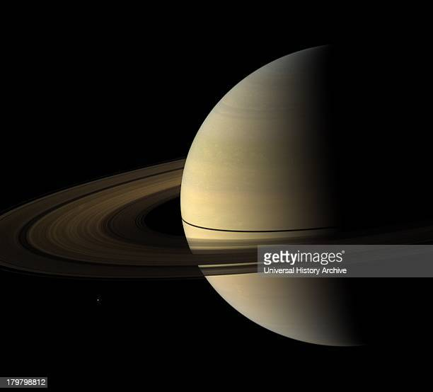 The Cassini spacecraft captured this natural color view of Saturn almost a month after the planet's August 2009 equinox The shadow cast on the planet...