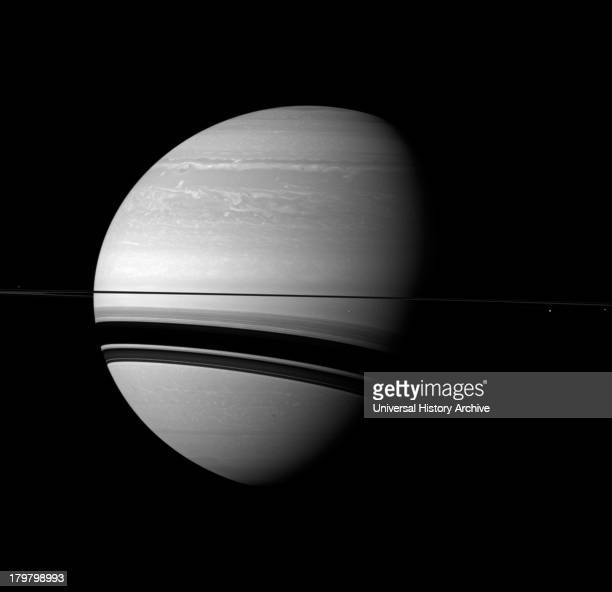 The Cassini spacecraft examines Saturn and the planet's northern hemisphere which was ravaged by a huge storm for much of 2011