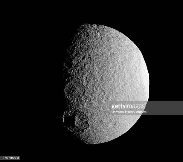 The Cassini spacecraft takes a close look at a row of craters on Saturn's moon Tethys during the spacecraft's April 14 flyby of the moon