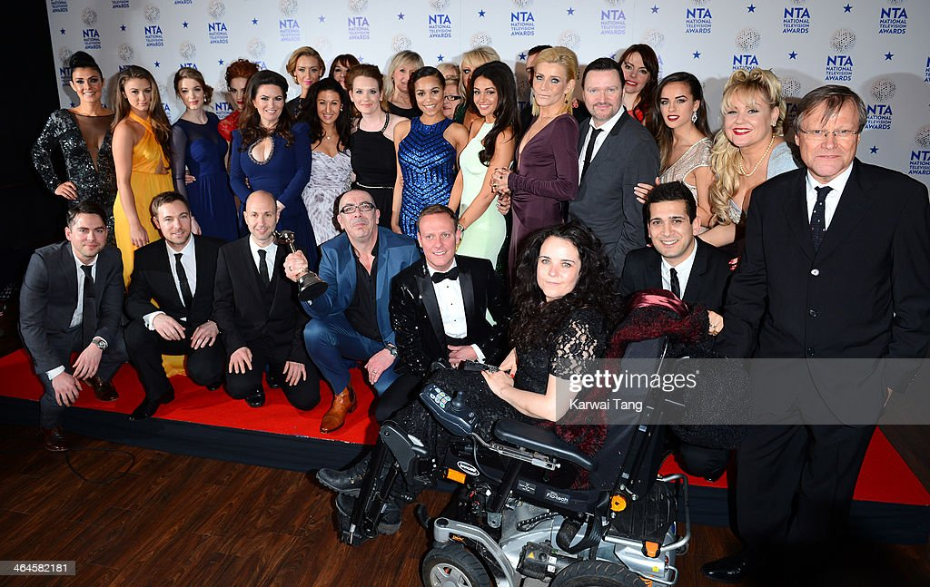 The cast and crew of 'Coronation Street' pose with their Serial Drama Award in front of the winners boards at the National Television Awards 2014 on January 22, 2014 in London, England.