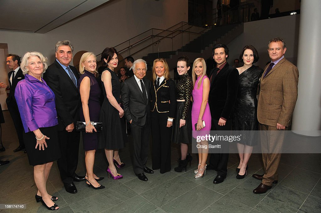 The cast and crew of 'Downton Abbey' pose with Ralph Lauren at an evening with the cast and producers of PBS Masterpiece series 'Downton Abbey' hosted by Ralph Lauren & Graydon Carter on December 10, 2012 in New York City.