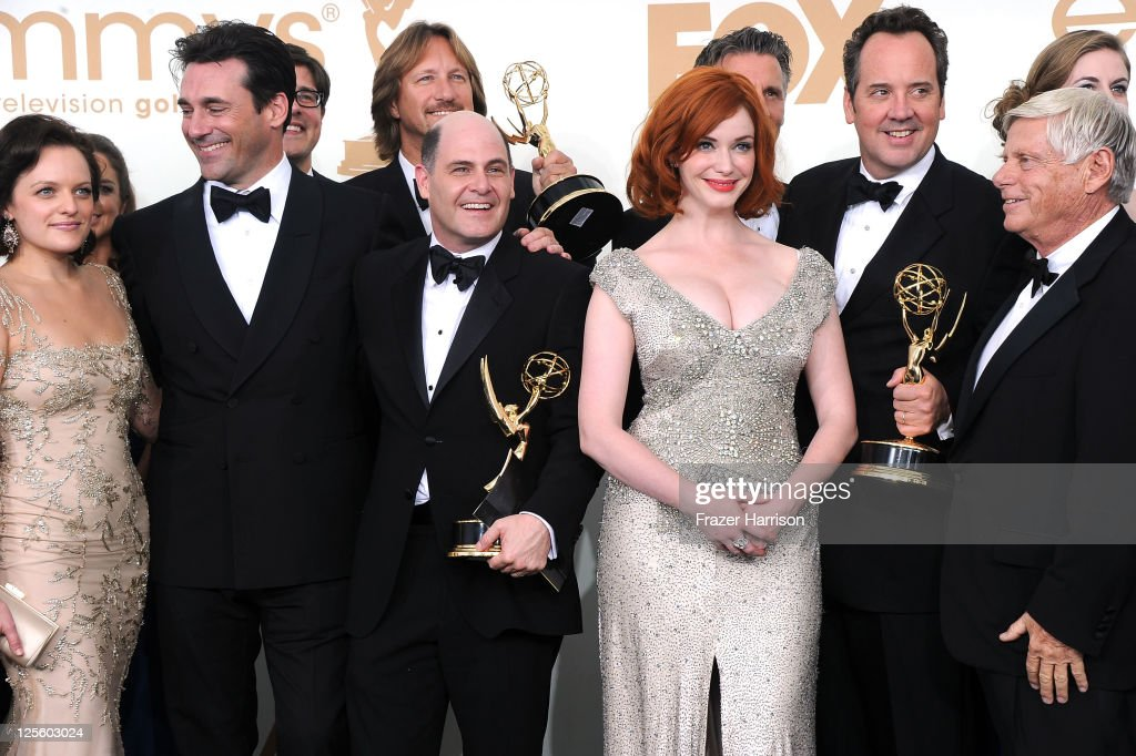 The cast and crew of 'Mad Men' including Elisabeth Moss, <a gi-track='captionPersonalityLinkClicked' href=/galleries/search?phrase=Jon+Hamm&family=editorial&specificpeople=3027367 ng-click='$event.stopPropagation()'>Jon Hamm</a>, <a gi-track='captionPersonalityLinkClicked' href=/galleries/search?phrase=Matthew+Weiner&family=editorial&specificpeople=4148376 ng-click='$event.stopPropagation()'>Matthew Weiner</a>, <a gi-track='captionPersonalityLinkClicked' href=/galleries/search?phrase=Christina+Hendricks&family=editorial&specificpeople=2239736 ng-click='$event.stopPropagation()'>Christina Hendricks</a> and Robert Morse pose in the press room after 'Mad Men' wins Outstanding Drama Series during the 63rd Annual Primetime Emmy Awards held at Nokia Theatre L.A. LIVE on September 18, 2011 in Los Angeles, California.