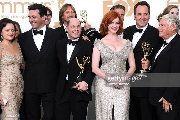 The cast and crew of 'Mad Men' including Elisabeth Moss Jon Hamm Matthew Weiner Christina Hendricks and Robert Morse pose in the press room after...