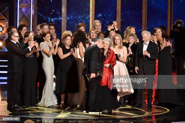 The cast and crew of 'The Handmaid's Tale' accepts an award onstage during the 69th Annual Primetime Emmy Awards at Microsoft Theater on September 17...