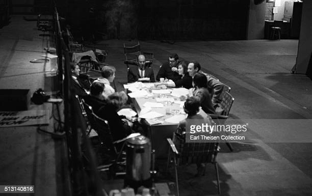 The cast and crew of the The Dick Van Dyke Show conduct a table read of the script on December 2 1963 in Los Angeles California