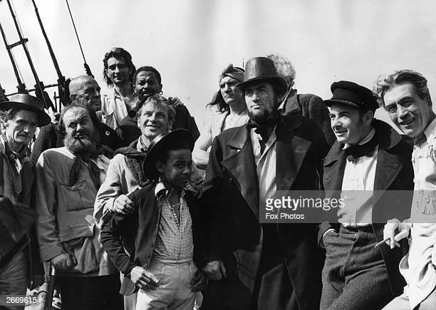 The cast and crew of the Warner Brothers film 'Moby Dick' on location in Youghal County Cork Members include Richard Basehart Gregory Peck as Captain...