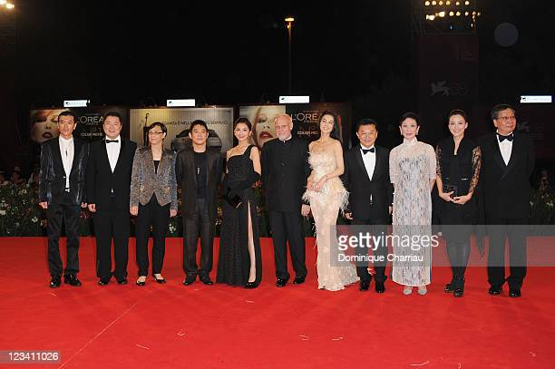 The cast and crew with Marco Muller Director of the Venice Film Festival attend the 'The Sorcerer And The White Snake' Premiere during the 68th...