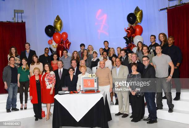 The cast and producers of 'The Young The Restless' pose at the 40th anniversary cakecutting ceremony at CBS Television City on March 26 2013 in Los...