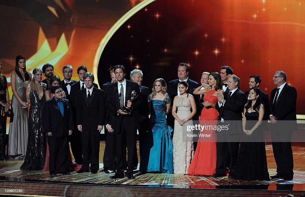 The cast & crew of 'Modern Family' accept the Outstanding Comedy Series award onstage during the 63rd Annual Primetime Emmy Awards held at Nokia Theatre L.A. LIVE on September 18, 2011 in Los Angeles, California.