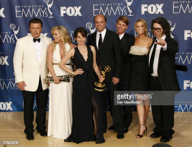 The cast of '30 Rock' pose in the pressroom with their Emmy during the 59th Annual Primetime Emmy Awards at the Shrine Auditorium on September 16...