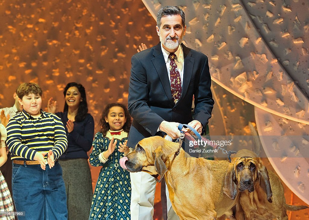 The cast of 'A Christmas Story: The Musical' and the bumpus's dogs Pete and Lily perform during 'A Christmas Story: The Musical' broadway opening at Lunt-Fontanne Theatre on November 19, 2012 in New York City.