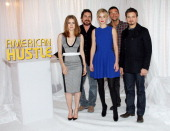 The cast of 'American Hustle' Christian Bale Amy Adams Bradley Cooper Jennifer Lawrence and Jeremy Renner attend the cast photo call for 'American...