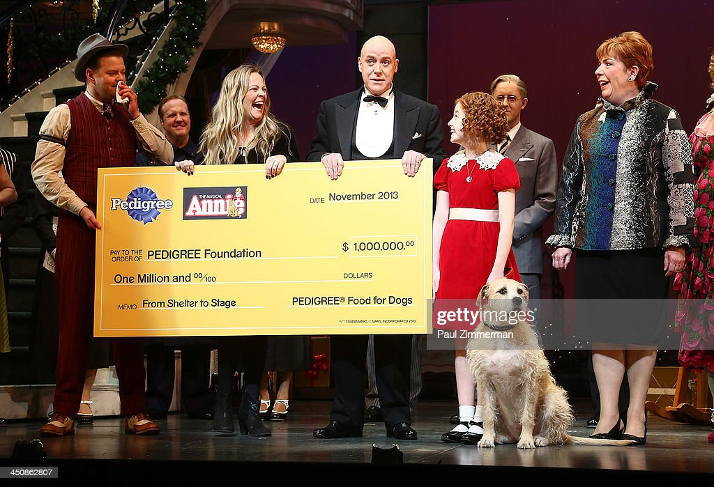 The cast of 'Annie' attends the 'Annie The Musical' on Broadway's 'See the Show Help a Dog Initiative Check Presentation' at Palace Theatre on...